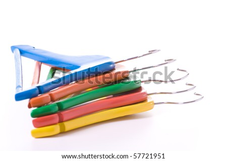 Colorful children clothes hangers isolated on white background.