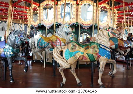 Colorful children's carousel at the Santa Monica Pier in Southern California - stock photo
