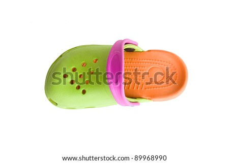 Colorful children's rubber sandals isolated on the white background