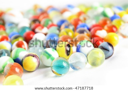 Colorful childrens' marbles assorted on a white background
