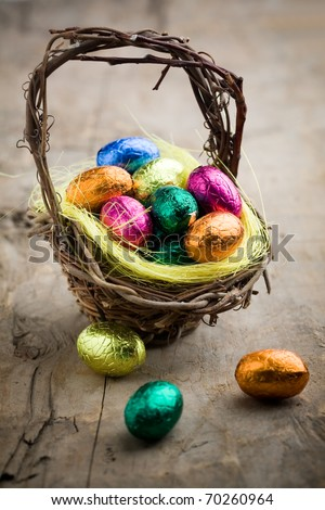 Colorful chocolate easter eggs in brown basket