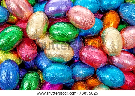 colorful chocolate easter eggs in closeup can be used as background