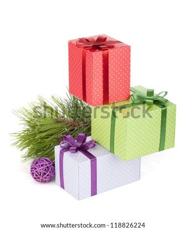 Colorful christmas gift boxes, fir tree and decor. Isolated on white background