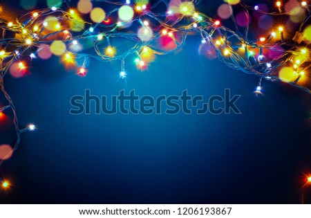 colorful christmas lights on blue background