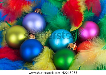 Colorful Christmas ornament balls globes and feathers.