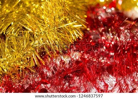 Colorful Christmas tinsel. New year's fluffy gold tinsel, tinsel, and pink tinsel. Sparkling ornament decoration concept.  #1246837597