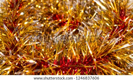 Colorful Christmas tinsel. New year's fluffy gold tinsel, tinsel, and pink tinsel. Sparkling ornament decoration concept.  #1246837606