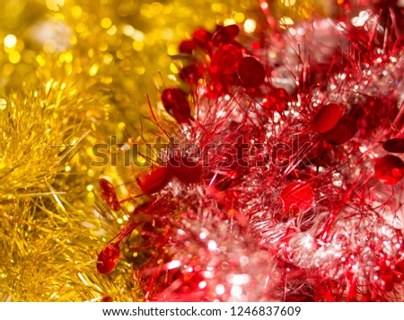 Colorful Christmas tinsel. New year's fluffy gold tinsel, tinsel, and pink tinsel. Sparkling ornament decoration concept.  #1246837609