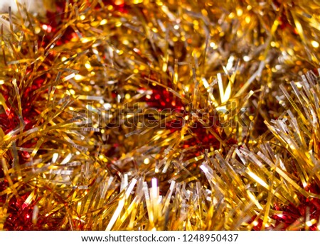 Colorful Christmas tinsel. New year's fluffy gold tinsel, tinsel, and pink tinsel. Sparkling ornament decoration concept.  #1248950437