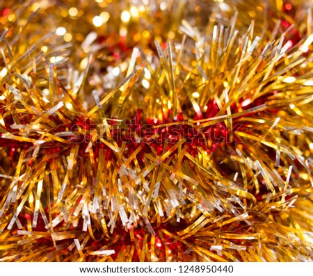 Colorful Christmas tinsel. New year's fluffy gold tinsel, tinsel, and pink tinsel. Sparkling ornament decoration concept.  #1248950440
