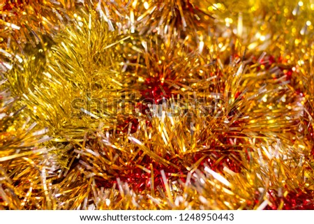 Colorful Christmas tinsel. New year's fluffy gold tinsel, tinsel, and pink tinsel. Sparkling ornament decoration concept.  #1248950443