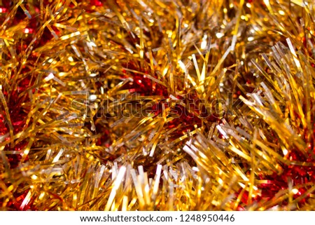 Colorful Christmas tinsel. New year's fluffy gold tinsel, tinsel, and pink tinsel. Sparkling ornament decoration concept.  #1248950446