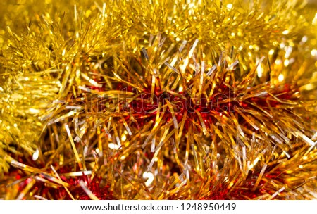 Colorful Christmas tinsel. New year's fluffy gold tinsel, tinsel, and pink tinsel. Sparkling ornament decoration concept.  #1248950449