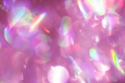 Colorful circles of light abstract background. Light Glitch Effect. Pink and purple glitter spots bokeh color. Defocused sparkling glittery texture. Blurred