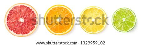Colorful citrus fruit slices isolated on white background, top view. Grapefruit, orange, lemon and lime #1329959102