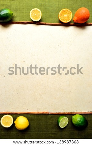 Colorful citrus fruits.frame,green background