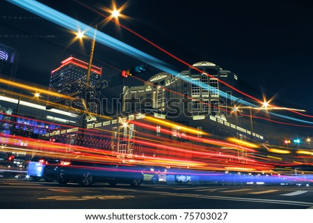 Colorful city night with lights of cars motion blurred in Taipei, Taiwan, Asia.
