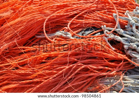 Colorful closeup of fishing nets in the fishing port of the city of IJmuiden in the Netherlands.