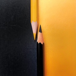 Colorful closeup of two pencils.  Amazing contrast.