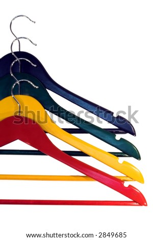 Colorful clothes-hangers isolated on white