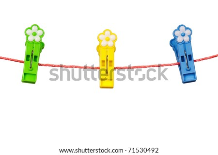 Colorful clothes-pegs on clothesline isolated on white background
