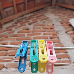 Colorful clothespin clothespins on the hangers. Plastic clothespins in different colors