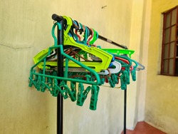 colorful clothing hangers, empty hangers with clips