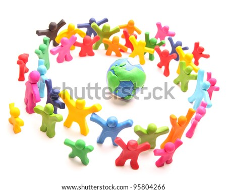colorful cloud of cheery plasticine people standing around planet earth to protect it