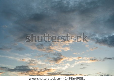 Colorful cloudy sky after rain, Beautiful evening skyscape. Sun's rays shine through hole in black clouds after rain. Sky, Golden sky. Natural background. Inspirational concept. #1498649081