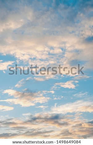 Colorful cloudy sky after rain, Beautiful evening skyscape. Sun's rays shine through hole in black clouds after rain. Sky, Golden sky. Natural background. Inspirational concept. #1498649084