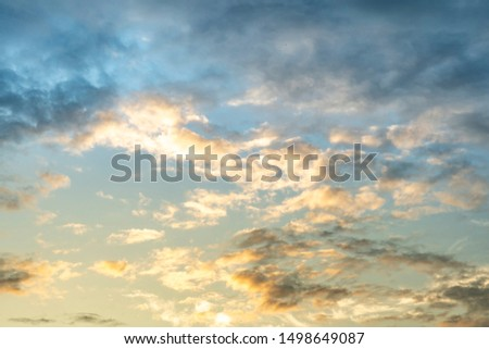 Colorful cloudy sky after rain, Beautiful evening skyscape. Sun's rays shine through hole in black clouds after rain. Sky, Golden sky. Natural background. Inspirational concept. #1498649087