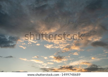 Colorful cloudy sky after rain, Beautiful evening skyscape. Sun's rays shine through hole in black clouds after rain. Sky, Golden sky. Natural background. Inspirational concept. #1499748689