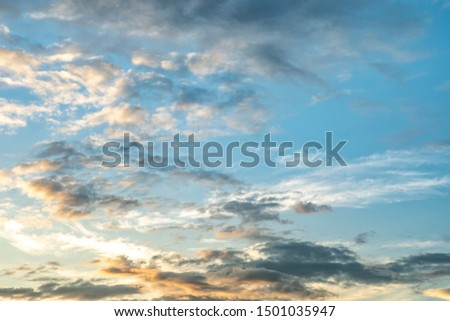 Colorful cloudy sky after rain, Beautiful evening skyscape. Sun's rays shine through hole in black clouds after rain. Sky, Golden sky. Natural background. Inspirational concept. #1501035947