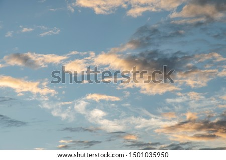 Colorful cloudy sky after rain, Beautiful evening skyscape. Sun's rays shine through hole in black clouds after rain. Sky, Golden sky. Natural background. Inspirational concept. #1501035950
