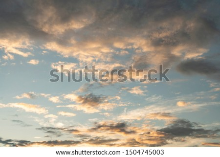 Colorful cloudy sky after rain, Beautiful evening skyscape. Sun's rays shine through hole in black clouds after rain. Sky, Golden sky. Natural background. Inspirational concept. #1504745003