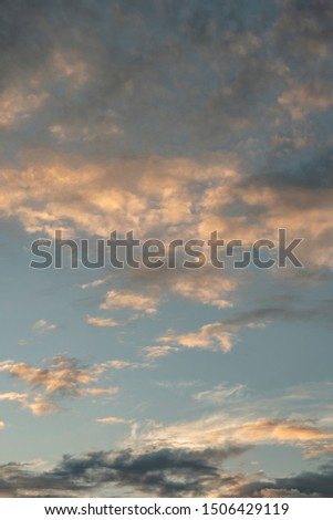 Colorful cloudy sky after rain, Beautiful evening skyscape. Sun's rays shine through hole in black clouds after rain. Sky, Golden sky. Natural background. Inspirational concept. #1506429119