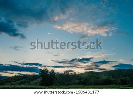 Colorful cloudy sky after rain, Beautiful evening skyscape. Sun's rays shine through hole in black clouds after rain. Sky, Golden sky. Natural background. Inspirational concept. #1506431177