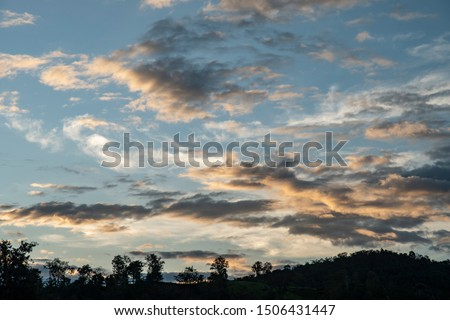 Colorful cloudy sky after rain, Beautiful evening skyscape. Sun's rays shine through hole in black clouds after rain. Sky, Golden sky. Natural background. Inspirational concept. #1506431447