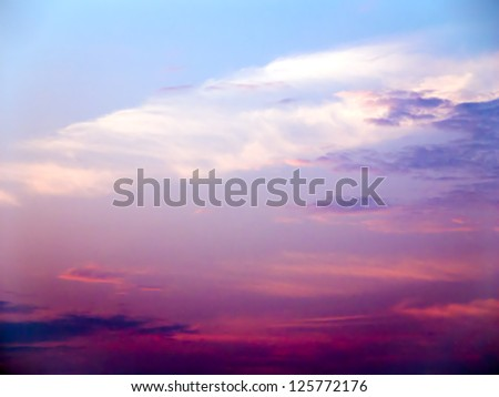 Colorful Cloudy Sky with the Sun Low on the Horizon