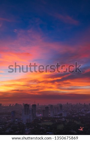 Colorful cloudy sunset #1350675869