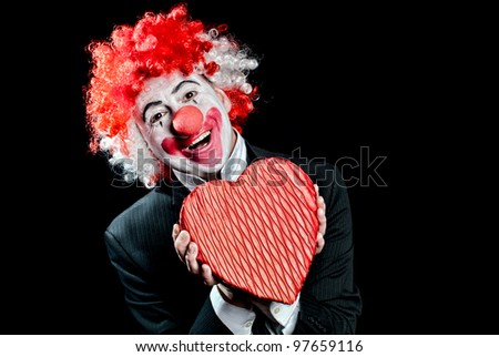 colorful clown with a box of candy  on a black background