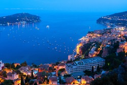 colorful coast with boats and ships, cote dAzur Provence, at blue night, France