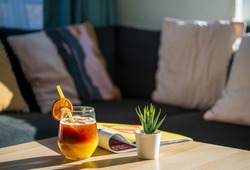 Colorful cocktail drink in a relaxing afternoon at home. Exotic cocktail made from Black Coffee Rum mixed with sweet fruit juice on Iced. Iced Coffee With orange Juice. Drink after work at home.