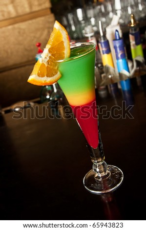 Colorful cocktail isolated on bar background, inclined perspective
