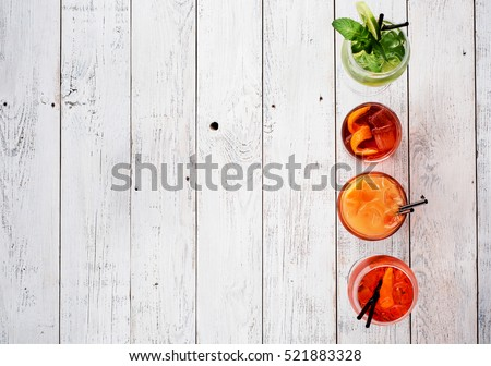 Shutterstock Colorful cocktails close up Top view. Negroni, Spritz Aperol, Martini royale.