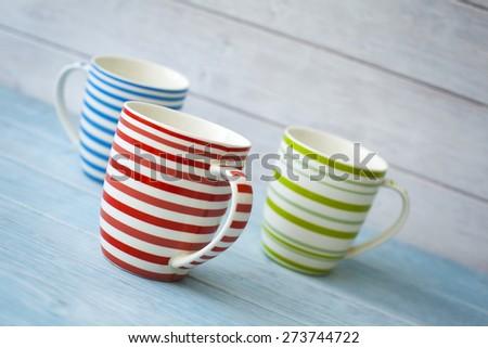 Colorful coffee mugs shot on an angle