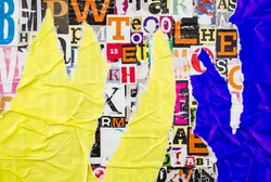 Colorful collage from clippings with letters and numbers. Torn and crumpled pieces of yellow and green paper.