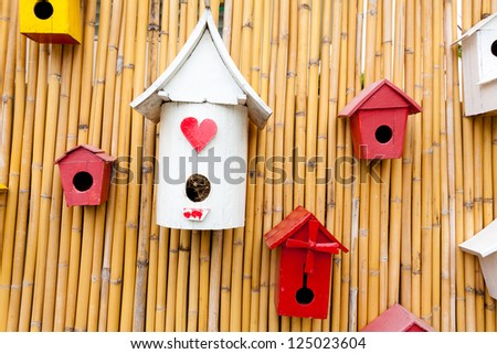 Colorful collection of birdhouses on wood wall