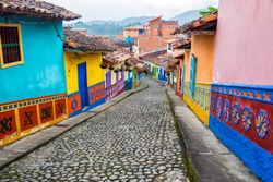 Colorful colonial houses on a cobblestone street in Guatape, Antioquia in Colombia