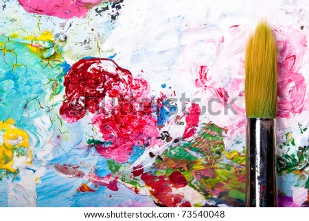 colorful color mixing palette with brush and text free space left